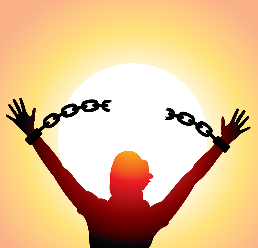 girl with raised hands and broken chains